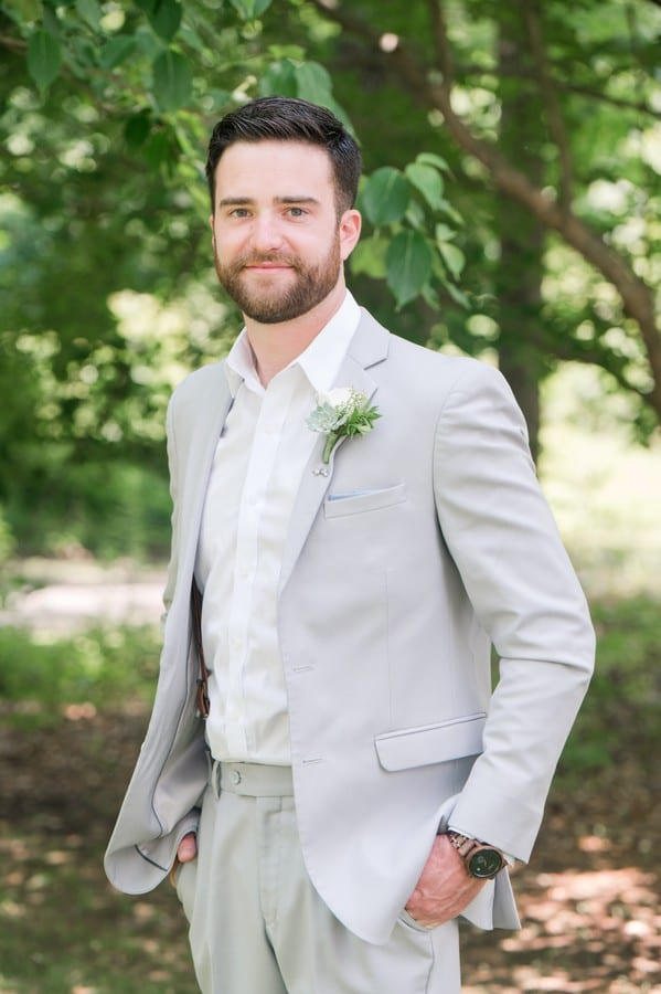 formal grooms portrait in his grey suit by Generation Tux
