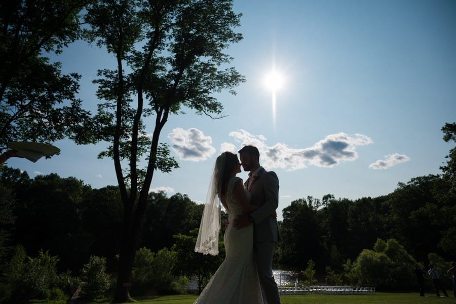 Silhouette image of a bride and groom at Mountain Lakes house