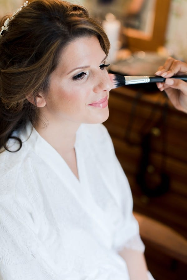 the bride having her makeup done by Michelle Renee Beauty