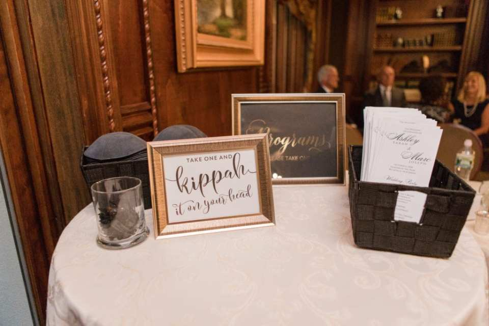 The wedding ceremony program and traditional kippah's on display in advance of the wedding ceremony