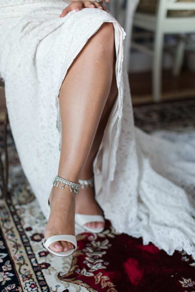 Bride wearing shoes by Nina