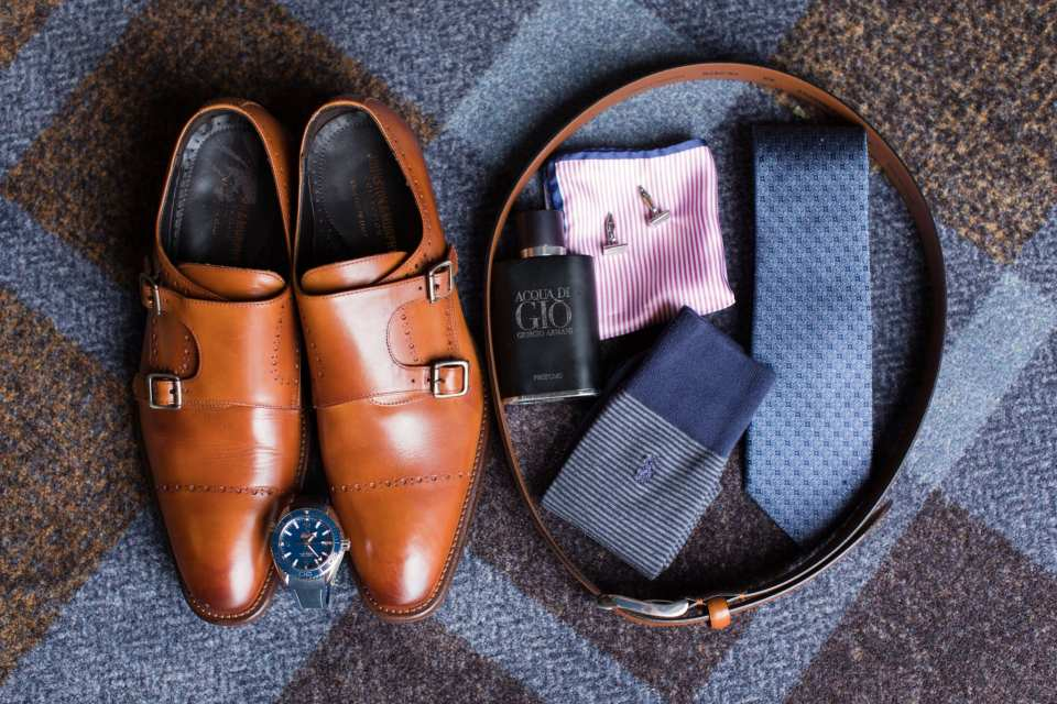 Grooms details including his brown shoes, belt, socks, tie, watch, and cologne