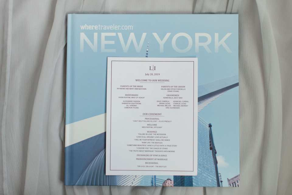Details of the wedding ceremony displayed on their program which sits on a book about New York City