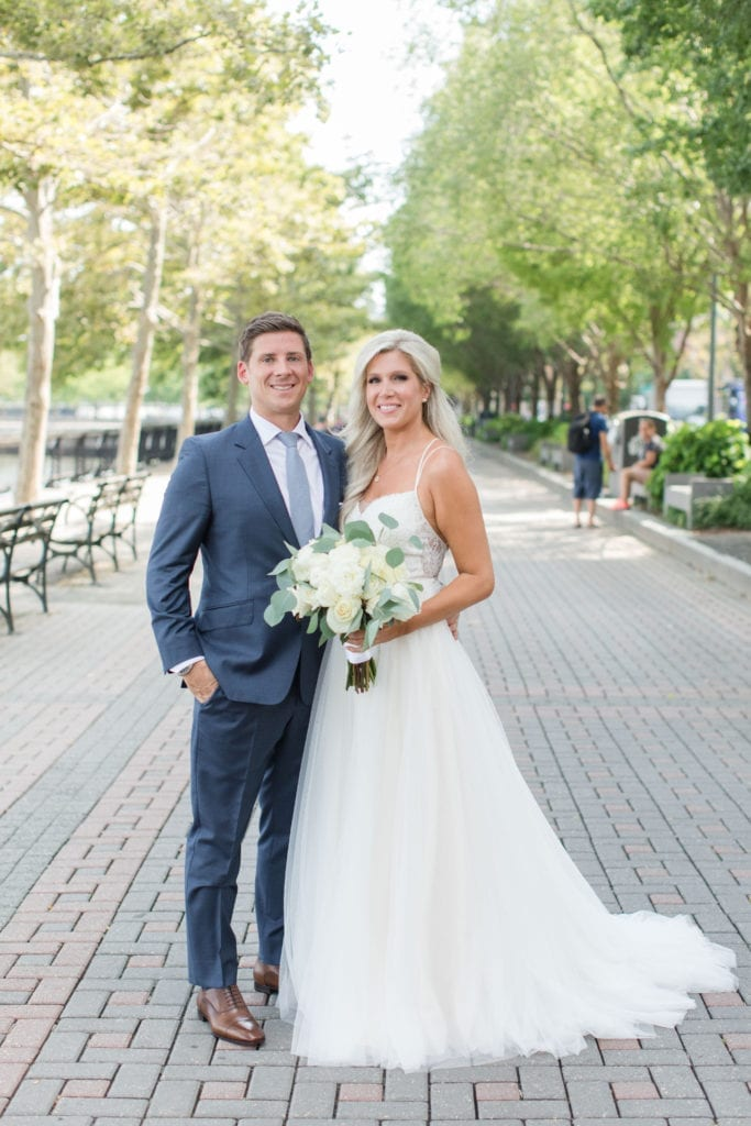 Formal portrait of the bride and groom on the waterfront in Hoboken, NJ by New Jersey wedding photographer Jaye Kogut Photography