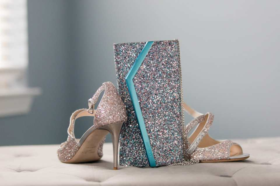 Brides Jimmy choo sparkly heels with coordinating custom sparkly clutch bag
