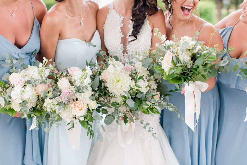 3/4 body shot of entire bridal party, all bouquets in focus