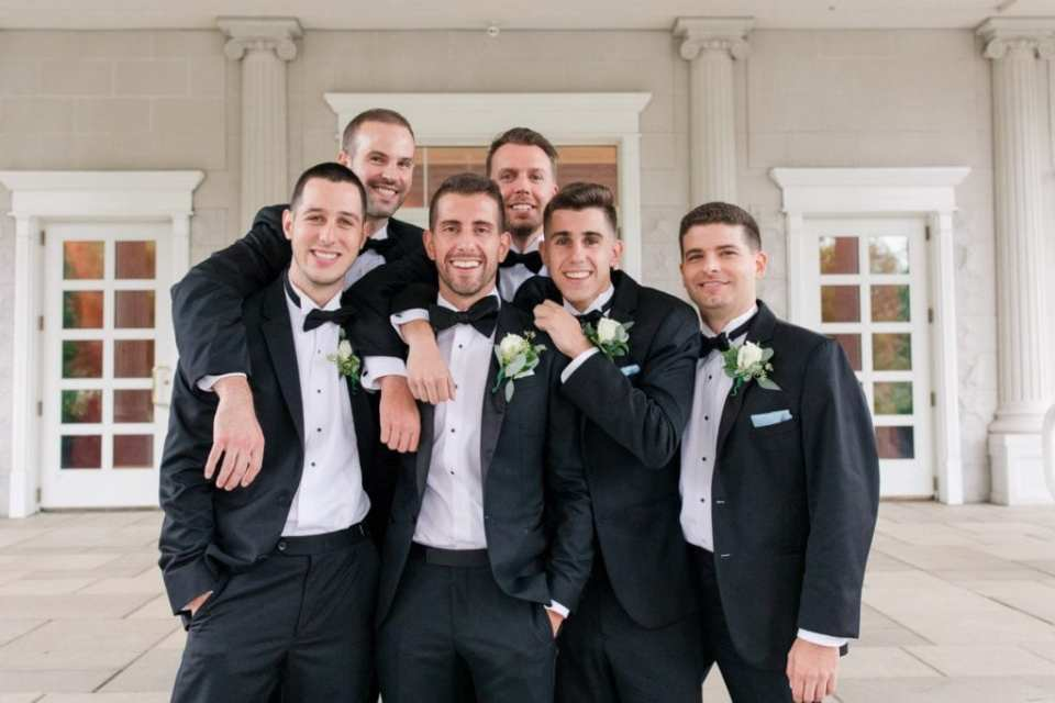 Fun photo of the groom with his groomsmen outside the Palace at Somerset Park