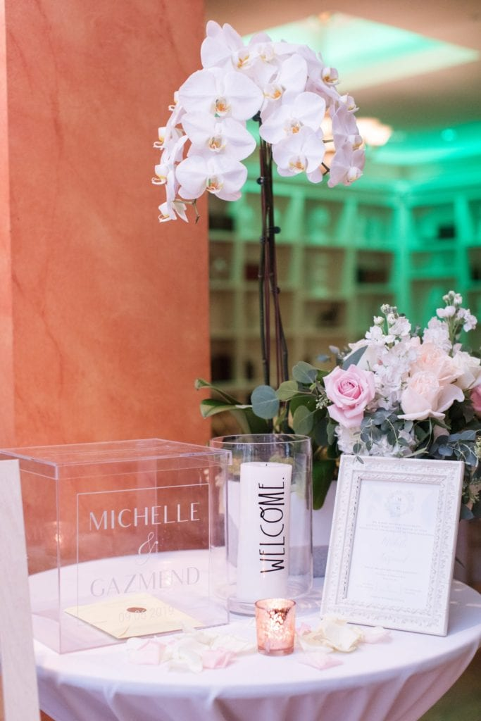 Entrance into the wedding; acrylic card box with bride and groom's name, invitation, candles and florals by Jacqueline's Florist on display