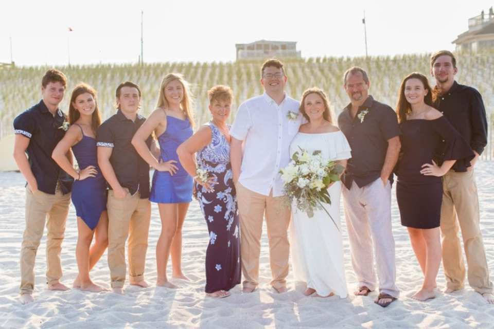 The bride and groom with their family and friends who attended their Lavallette Beach elopement