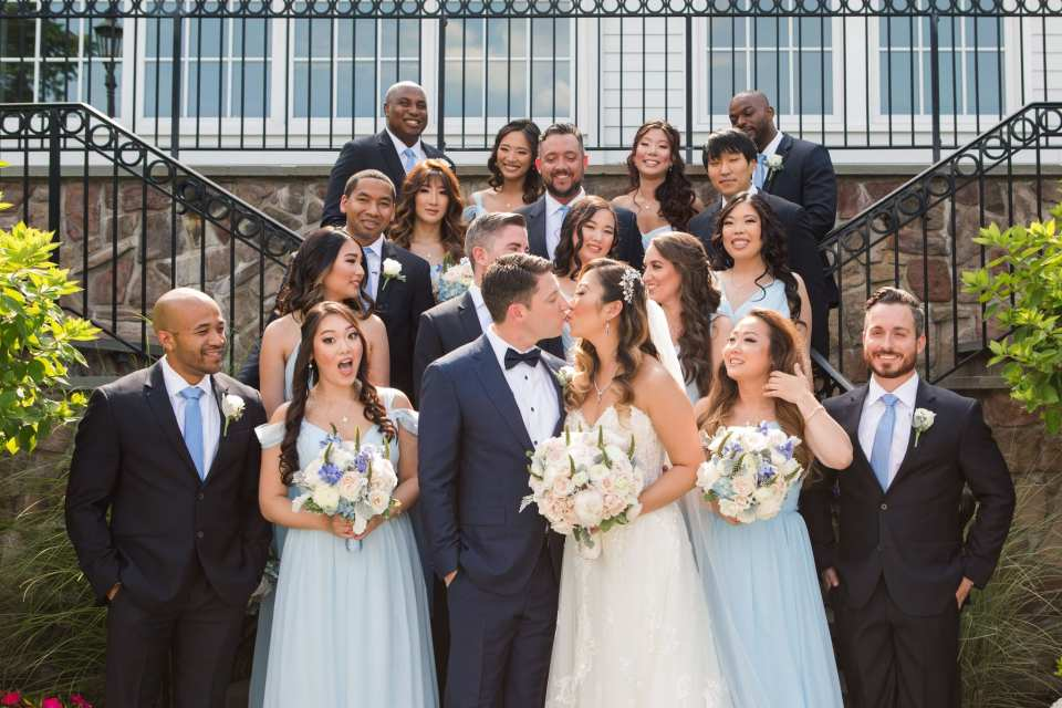Fun wedding party photo on the steps outside the Park Savoy Estate