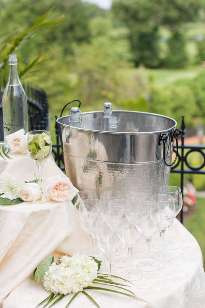 Wedding details: a water station for guests while waiting for the wedding ceremony to being at the Park Savoy Estate