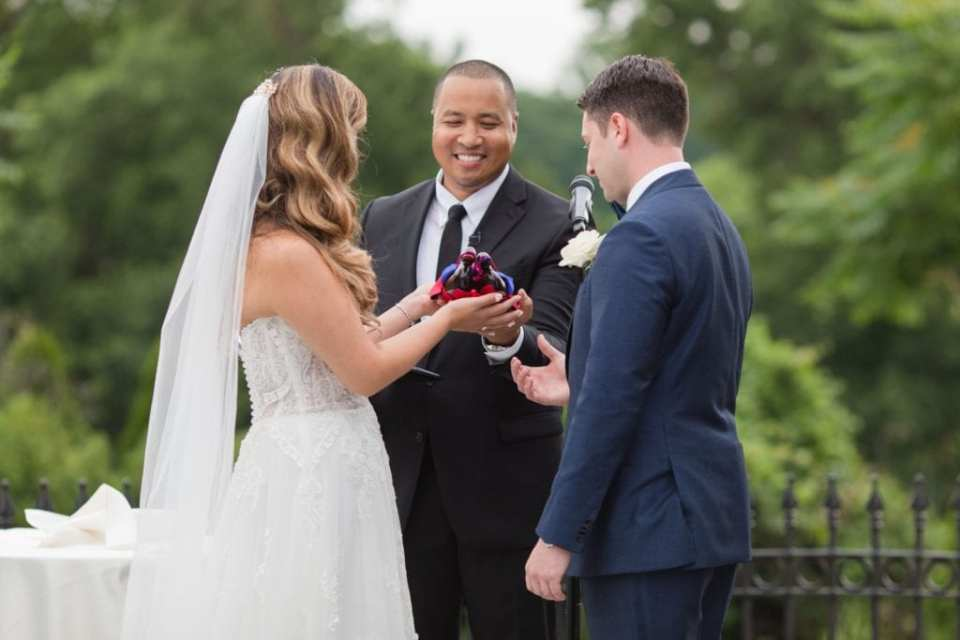 The officiant takes part in the wedding ceremony with the bride and groom