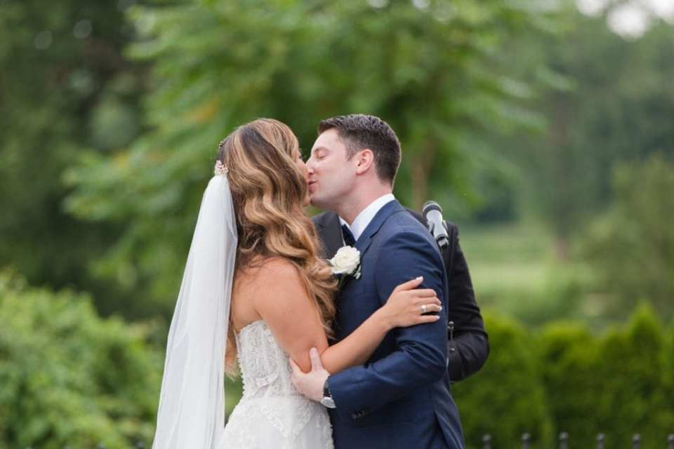 The bride and groom share their first kiss as husband and wife