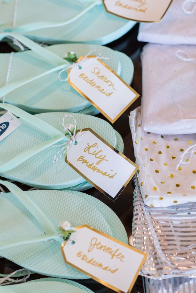 Flipflops with gold and white nametags
