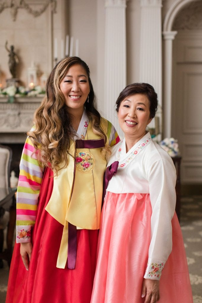 The bride and her mother in traditional Korean wedding wear