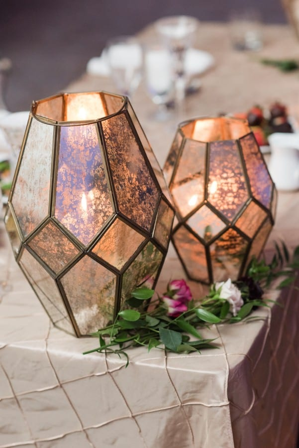 Unique glass candle holders by Petal Pushers accented with small florals on a patterned table covering in these Princeton Marriott at Forrestal Wedding Photos