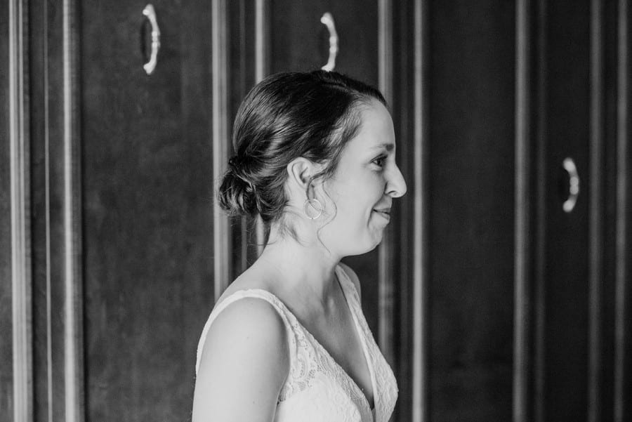 Black and white candid photo of the bride during prep, hair by Hello Beautiful Weddings