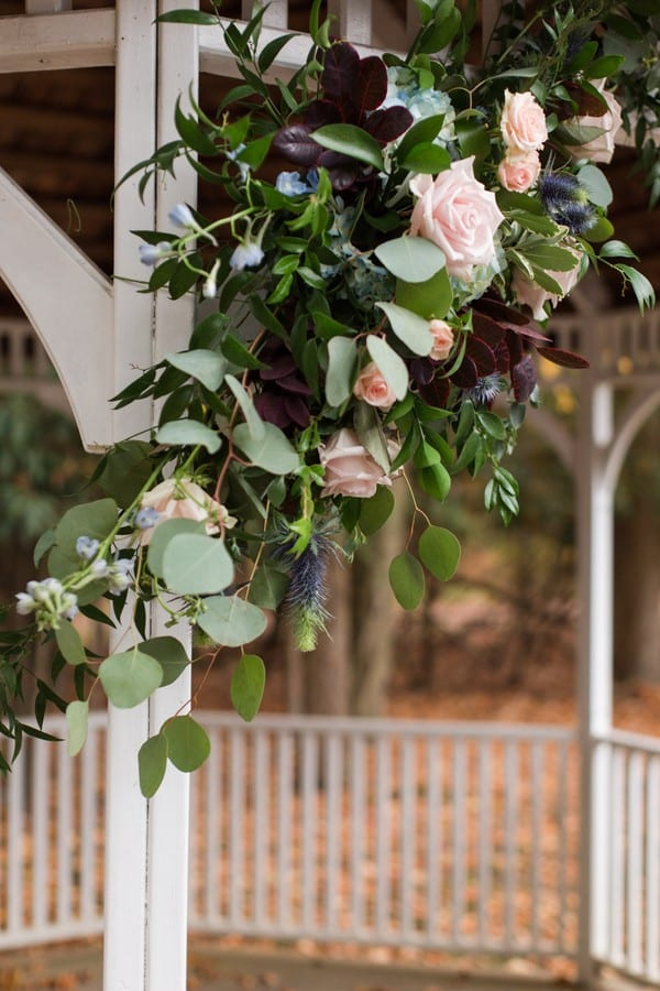 Close up of the mixed greens with blush floral decor by Petal Pushers on the gazebo for the Princeton Marriott at Forrestal wedding ceremony