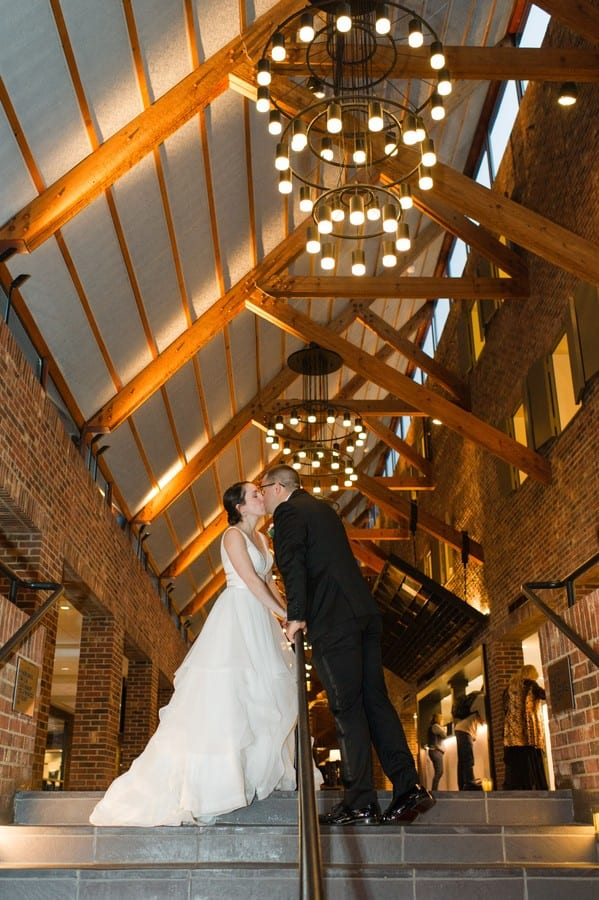 The bride and groom share a kiss inside their Princeton Marriott at Forrestal wedding