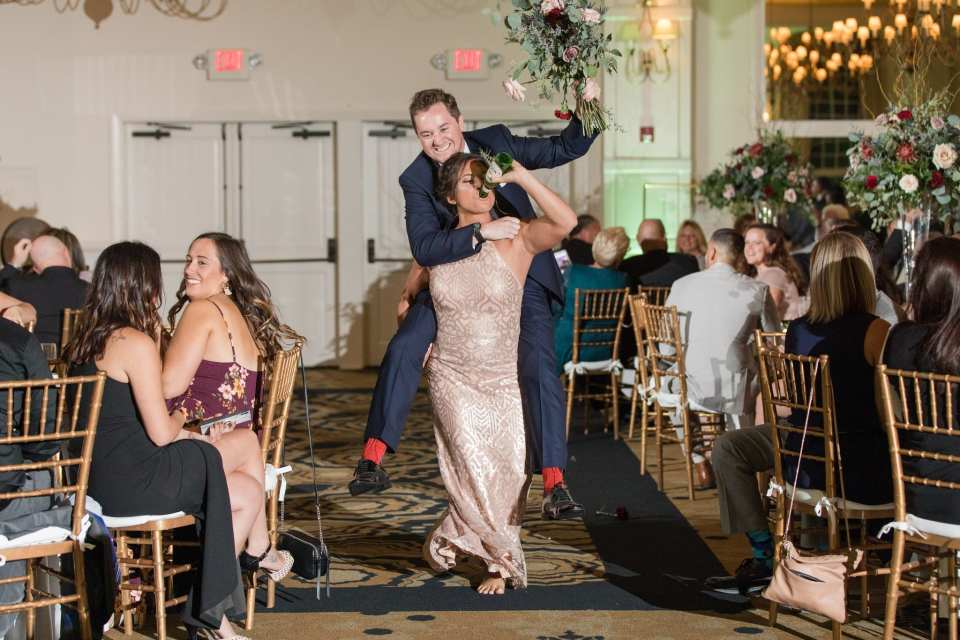 Members of the wedding party make a fun entrance into the wedding reception