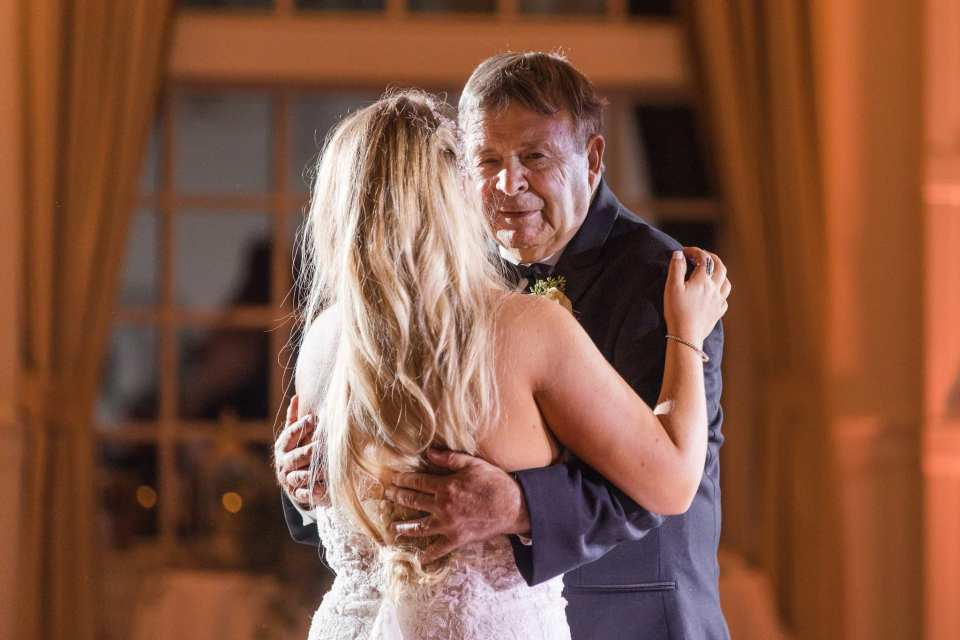 The bride shares a dance with her father