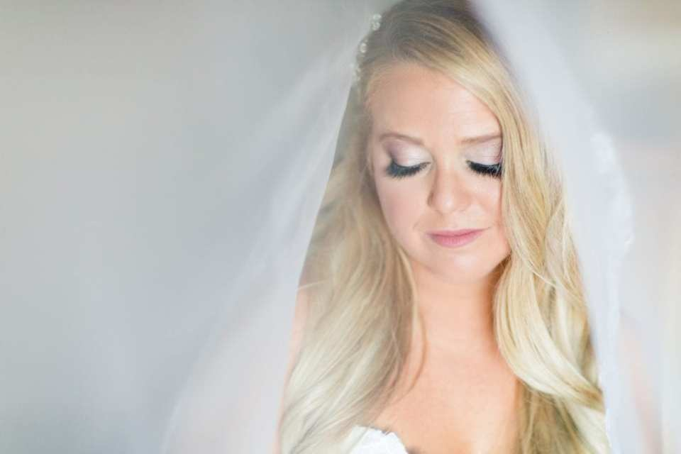 An under the veil photo of the bride. Makeup and Hair by Colorbar the Salon