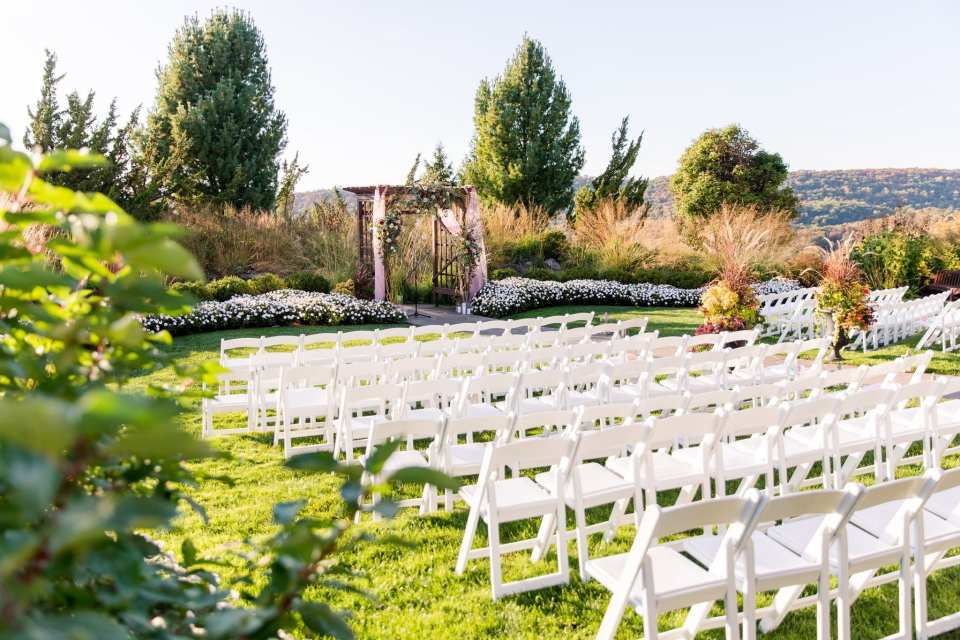 Wide angle photo of the outdoor ceremony area at the Grand Cascades Lodge at Crystal Springs Resort