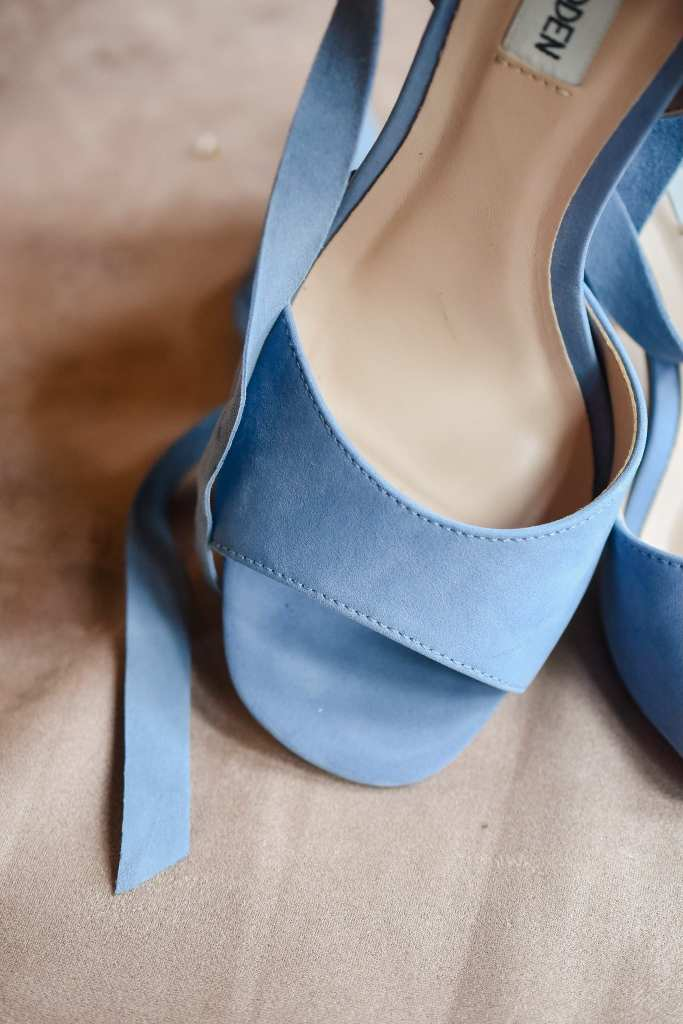 Close up of the brides light blue peep toe heels by Steve Madden