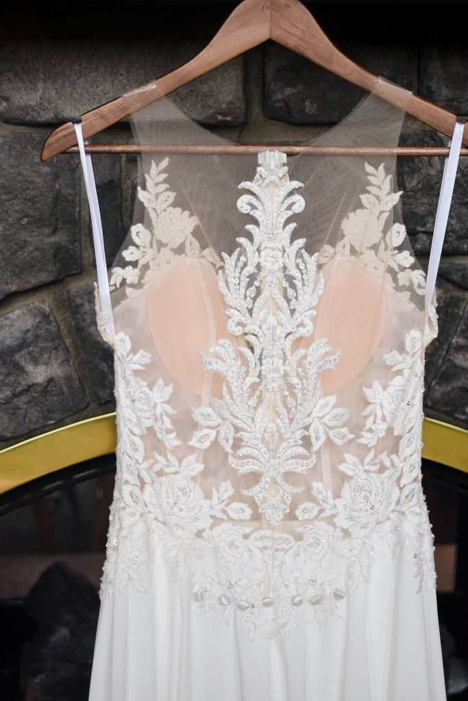 Close up of the detailed applique back of the brides gown by Allure Bridal