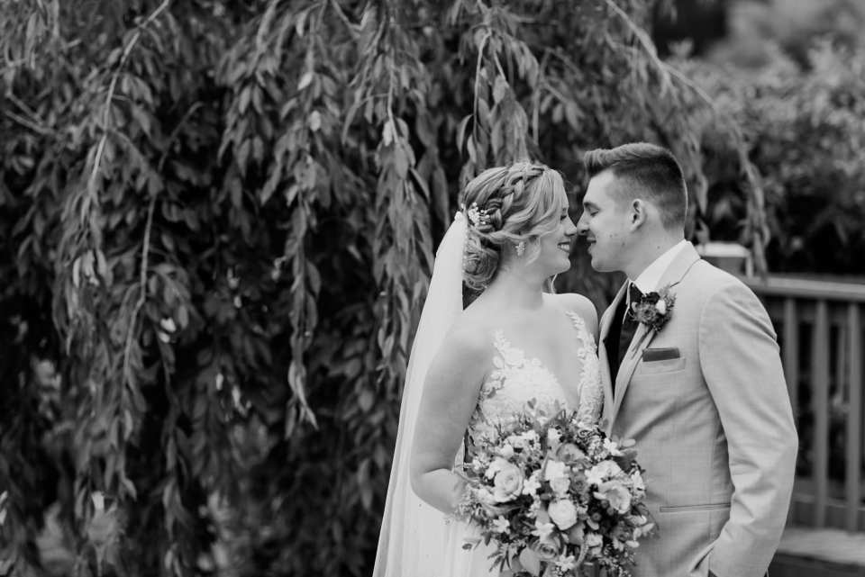 Black and white photo of the bride and groom smiling