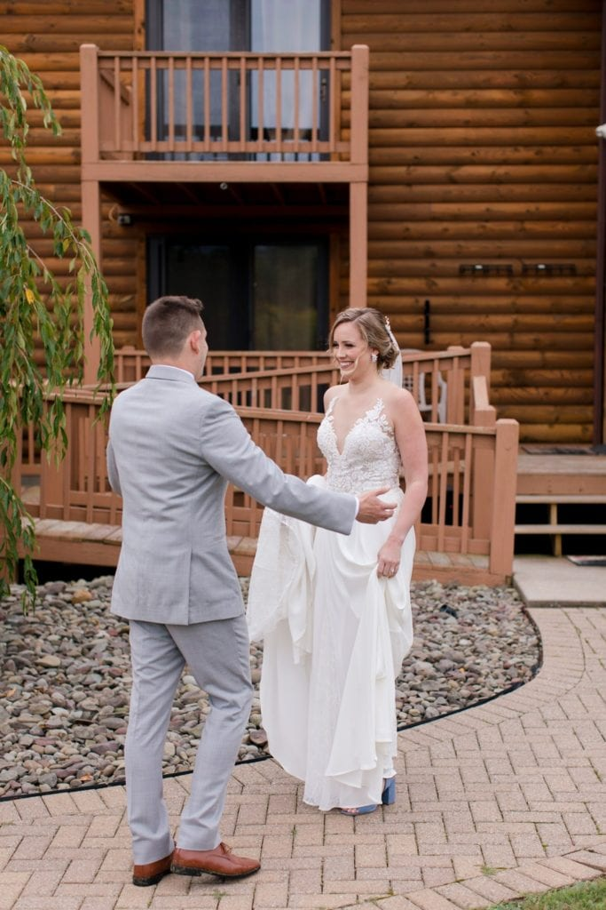 The groom goes to embrace his bride after seeing her for the first time
