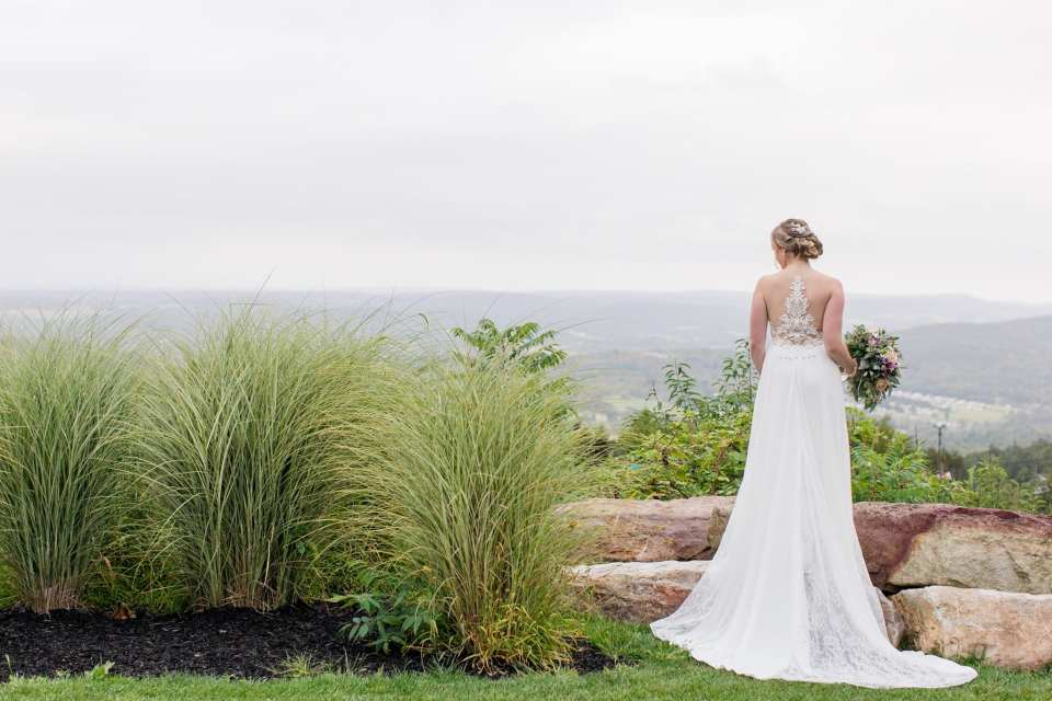 Wide angle photo of the back of the bride outside the Blue Mountain Resort