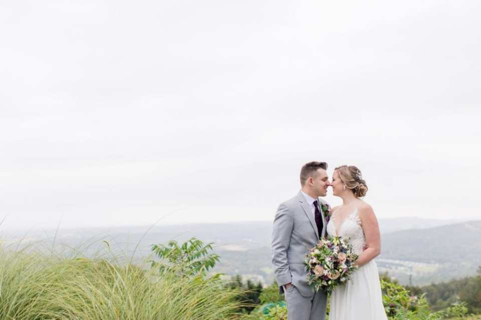 The bride and groom nose to nose outdoors for their Blue Mountain Resort wedding photos