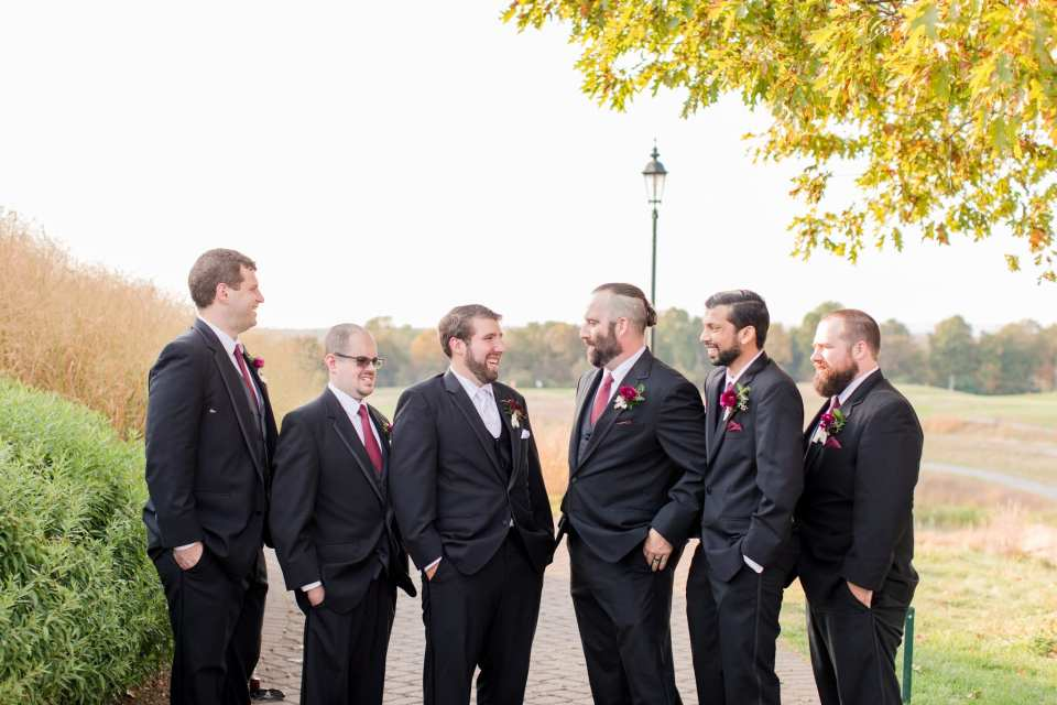Groom and his groomsmen in black suits by Men's Wearhouse at the Ballyowen Golf Course, Northern New Jersey