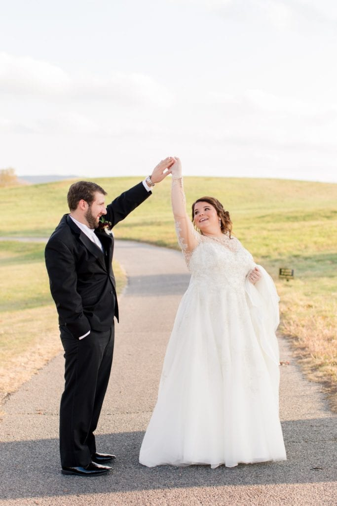 Bride and groom dancing on the golf cart path at Ballyowen Golf Course ClubhouseBallyowen Golf Course in background