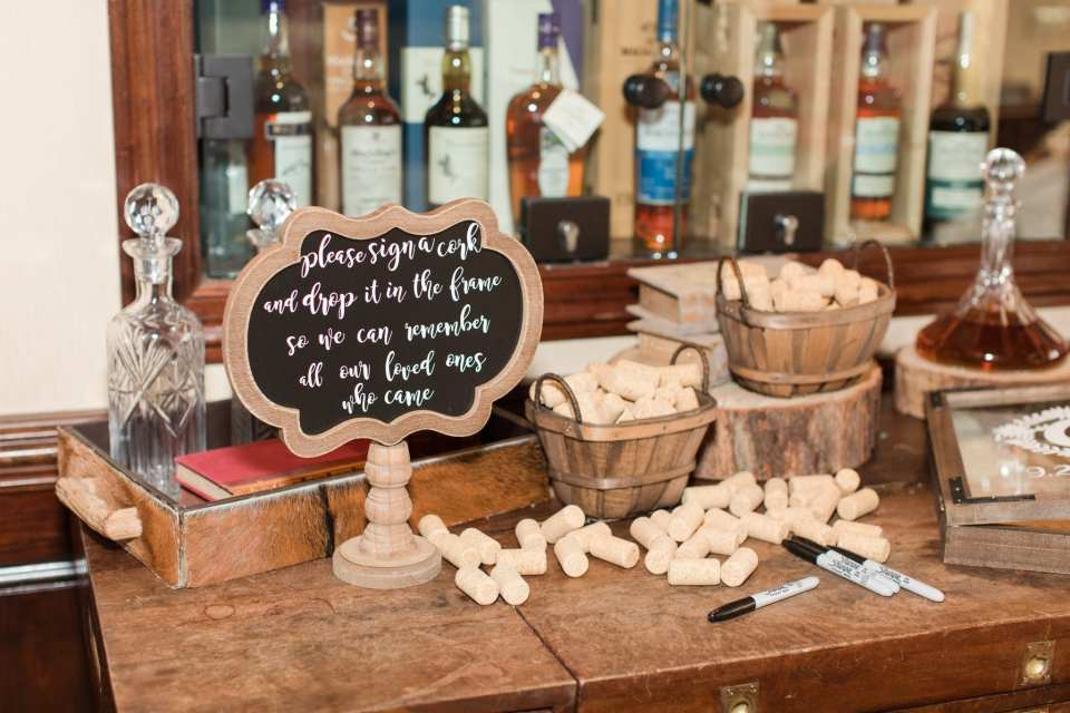 Wine cork guest book on display with instructions