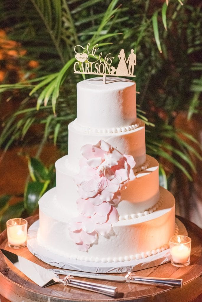 4 tier white wedding cake with blush floral accents by Cafe Pierrot and custom gold cake topper