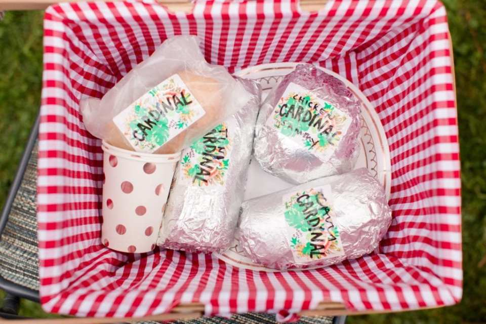 A picnic basket of sandwiches by Cardinal Provisions, caterer for this New Jersey Micro wedding