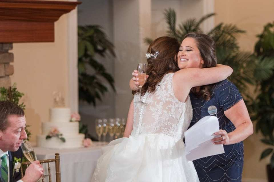 The bride hugs the maid of honor after giving her speech