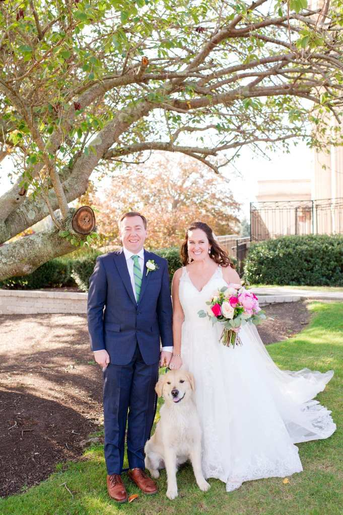 Formal portrait of the bride and groom and their dog
