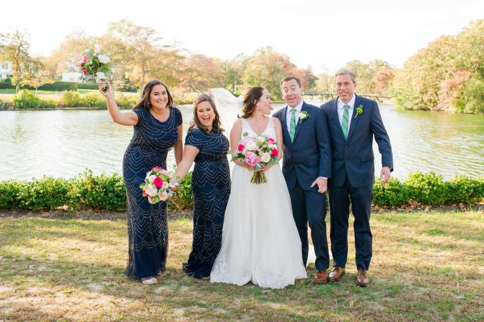 Fun portrait of the bride, groom and bridal party