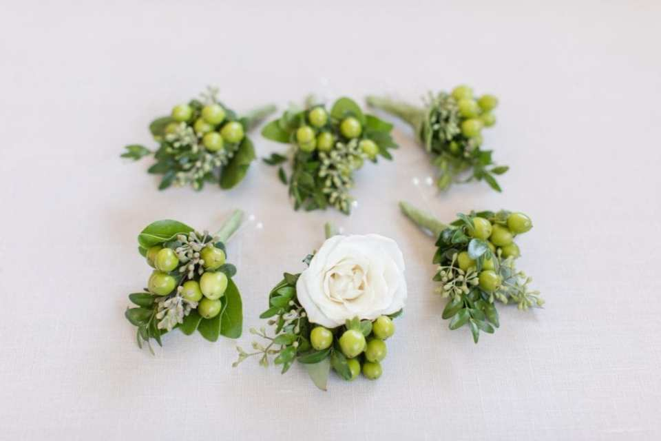 Boutonnieres of green berries and white rose by Wallflowers