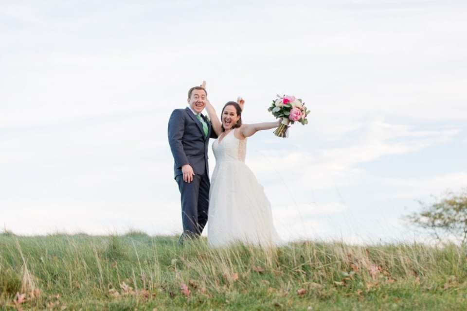 Fun photo of bride and groom amongst the rough at this Spring Lake Golf Club wedding
