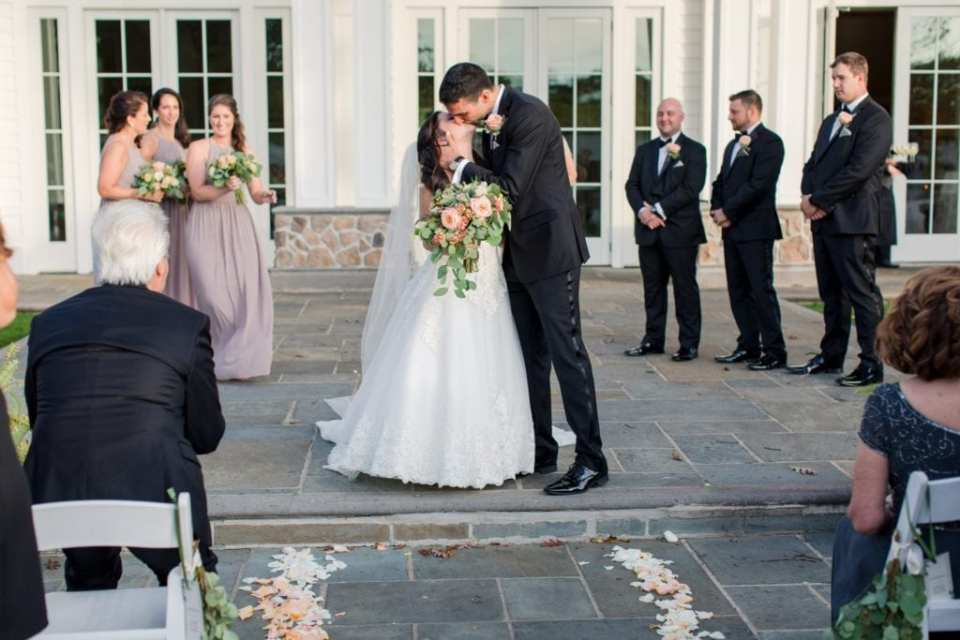 The bride and groom have their first kiss as husband and wife