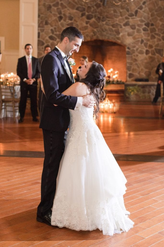 The bride and groom gazing into one anothers eyes as they take their first dance as husband and wife
