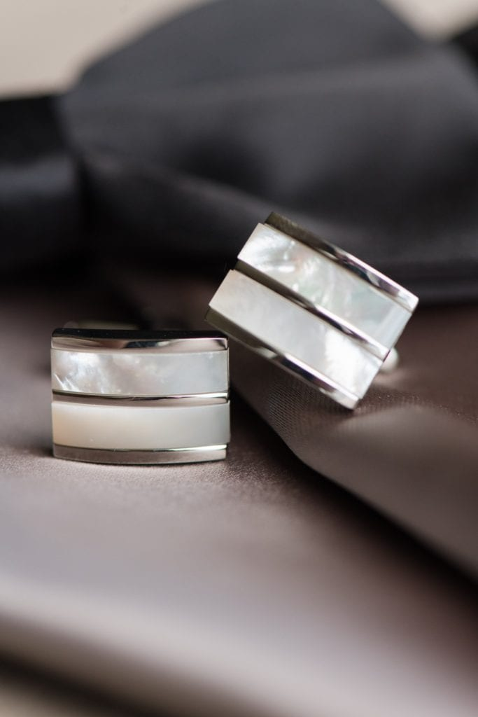 The grooms details: pearl and silver cufflinks