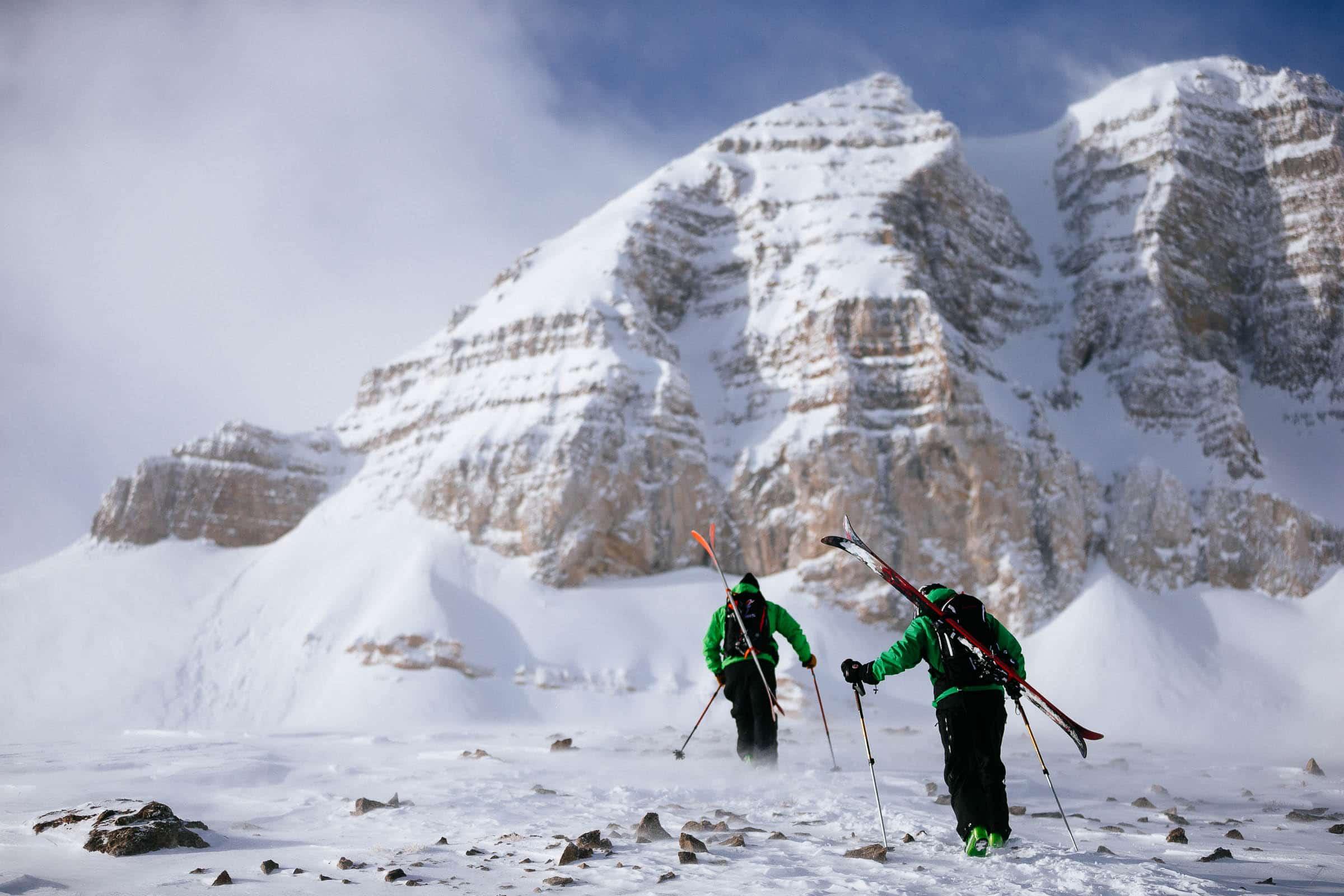 Sam Sehnert and Ethan Valenstein hike towards Powder 8 face off of Cody Peak