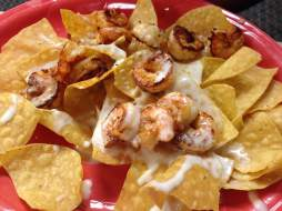 Mi Pueblo Real has the seafood lovers covered. Share or don't share these shrimp nachos.