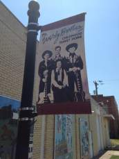 Public murals supply the backdrop to the Everly home on the main drag.