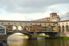 The famous Ponte Vecchio bridge with its famous jewelry stores, which began as butcher shops. The top windows were along a private walkway for Ferdinando l. He evicted the butchers in the 16th century because he couldn't stand the smell as he walked overhead. Jewelry has been sold in the shops ever since.